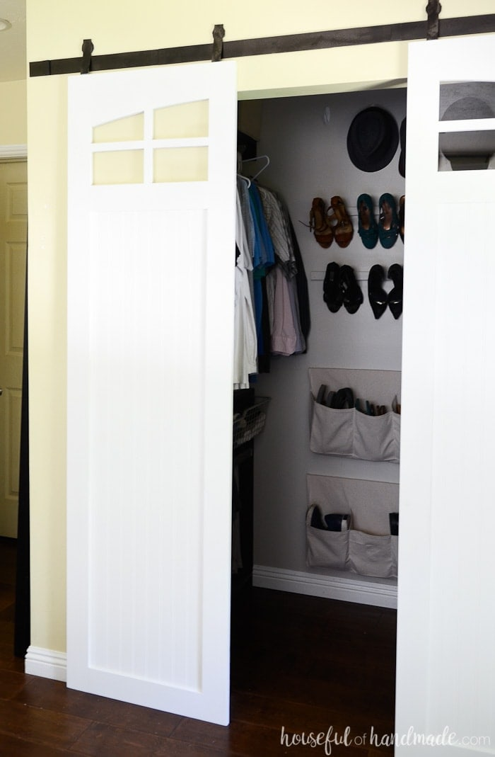 If you don't like bifold or mirrored closet doors, these sliding barn doors are the perfect solution. The curved windows are my favorite part of these DIY farmhouse barn doors. Housefulofhandmade.com