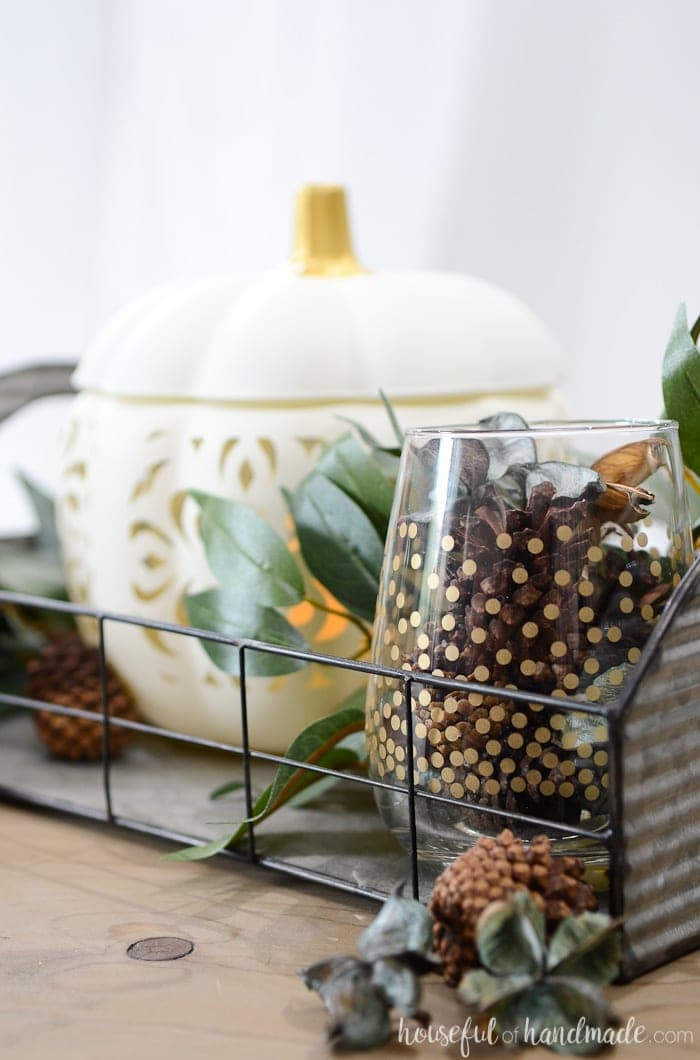 Create the perfect vignette for fall with this easy filigree punched ceramic pumpkin craft. Housefulofhandmade.com