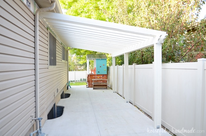 Build a pergola on a budget! Learn how to use inexpensive wood but make it look amazing. Housefulofhandmade.com