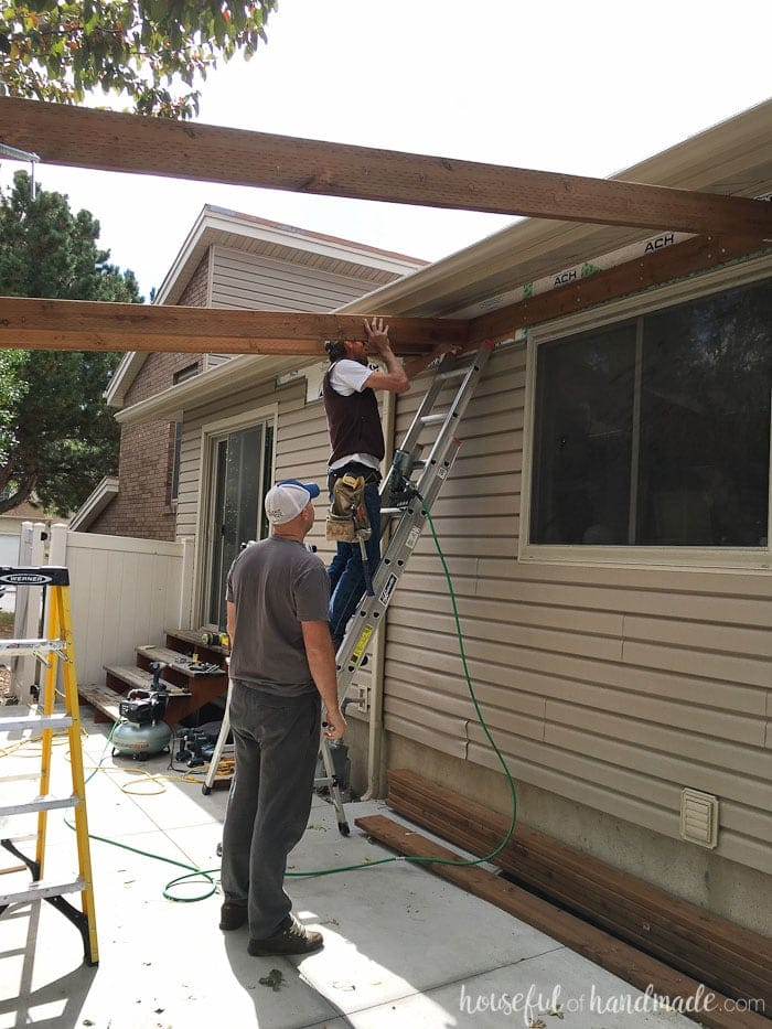 Building a pergola attached to the house. How to attach cross beams to the header. Housefulofhandmade.com