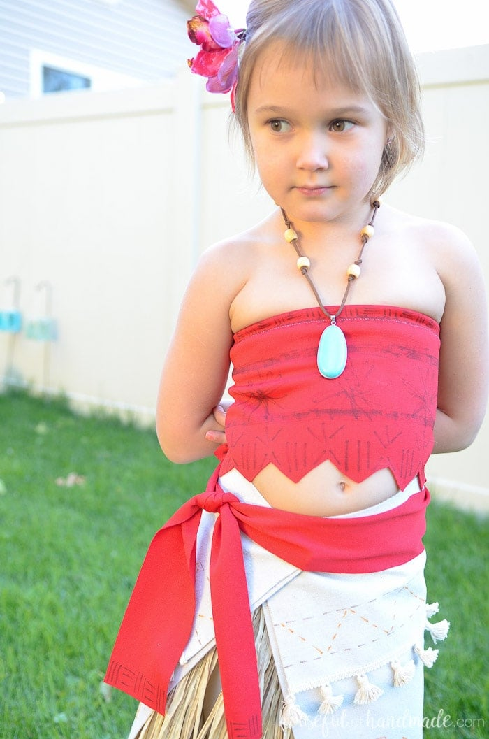 DIY Moana Halloween costume with red top and ivory skirt with tassles.