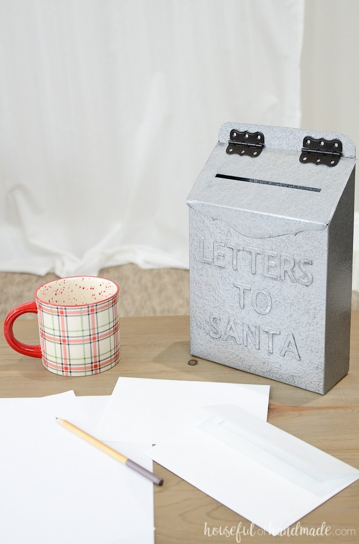 Get ready for Christmas with this easy DIY Christmas decor idea. Make a Santa mailbox out of an old cereal box. It's so easy! Housefulofhandmade.com