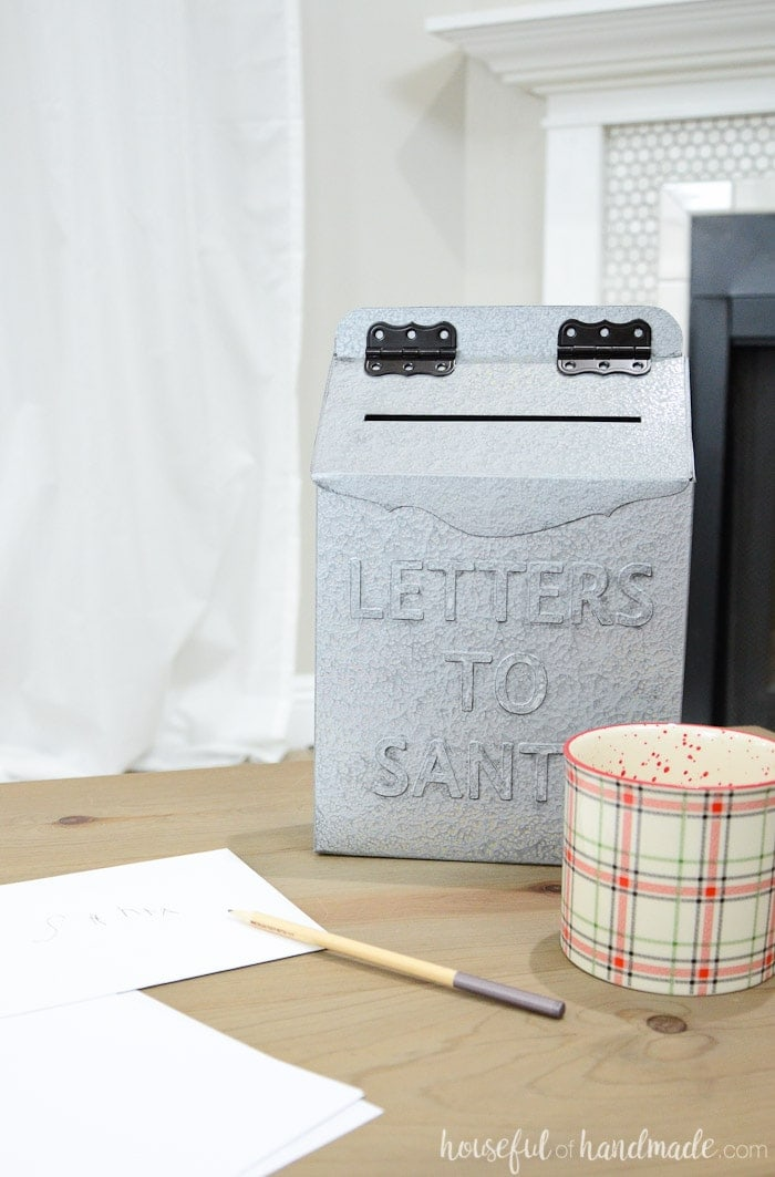 Create a faux metal Letters to Santa mailbox for Christmas with this amazing upcycle. Turn an empty cereal box into a vintage inspired Christmas mailbox. Housefulofhandmade.com