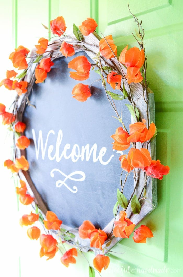 Need fun fall wreath ideas? This reclaimed wood chalkboard wreath is perfect for welcoming your guests during the season. The frame is built from reclaimed wood scraps. Housefulofhandmade.com