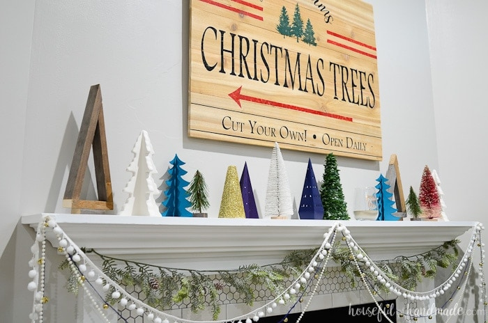 I love this beautiful holiday mantel decor. A forest of DIY Christmas trees is the perfect budget Christmas decor. Housefulofhandmade.com