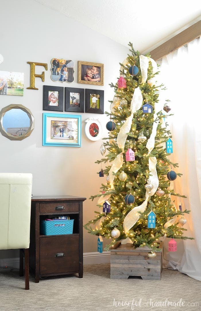 See how we decorated our modern farmhouse Christmas tree this year. I love all the homemade elements and pops of color. Housefulofhandmade.com