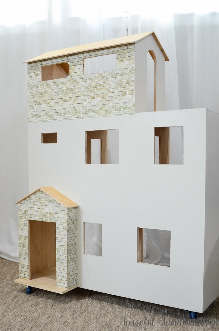 "A handmade dollhouse is the perfect gift for creative play. This plywood dollhouse is sized large enough to fit 11"" dolls and has plenty of rooms for hours of fun. Housefulofhandmade.com"