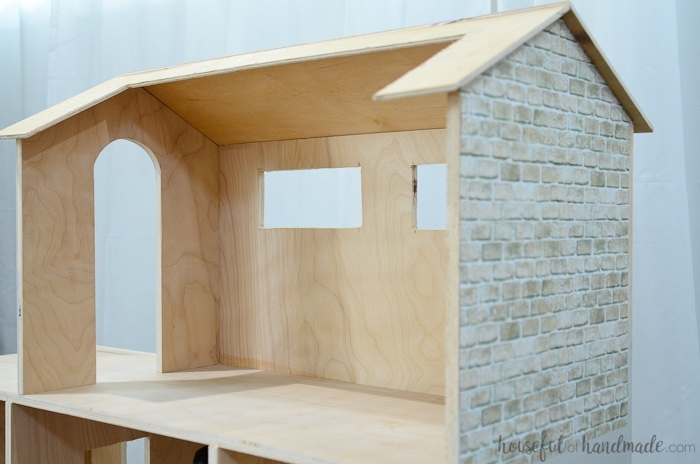 This beautiful handmade dollhouse was made out of plywood. It's the perfect DIY gift for girls. Housefulofhandmade.com