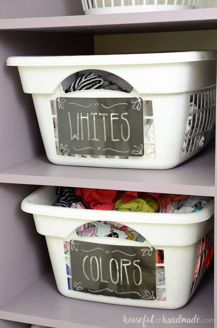 Farmhouse laundry room with black labels on white laundry baskets. Housefulofhandmade.com