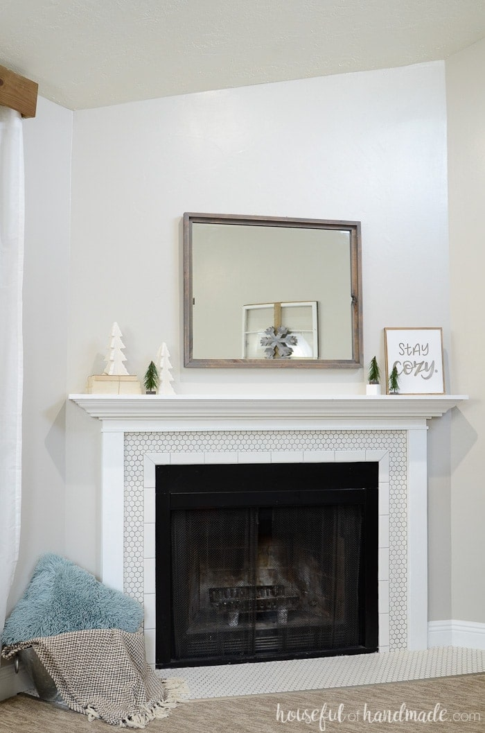 Neutral Christmas trees transition the mantel from festive to winter. Housefulofhandmade.com