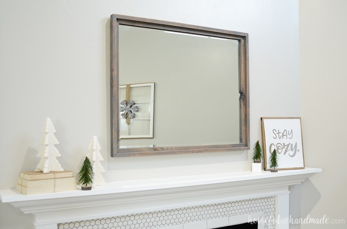 A large mirror over the mantel is such a classic. Add your favorite farmhouse decor to turn it into a simple farmhouse winter mantel. Housefulofhandmade.com