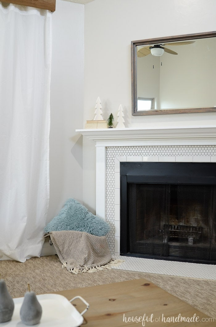 Decorating your mantel for winter can be hard after putting away all the Christmas decor. Keep it simple with a neutral farmhouse mantel and lots of clean space. See how we transitioned to winter with this simple winter mantel. Housefulofhandmade.com