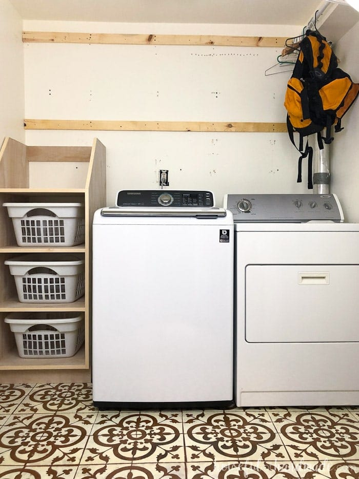 Laundry room with stackable laundry basket storage.