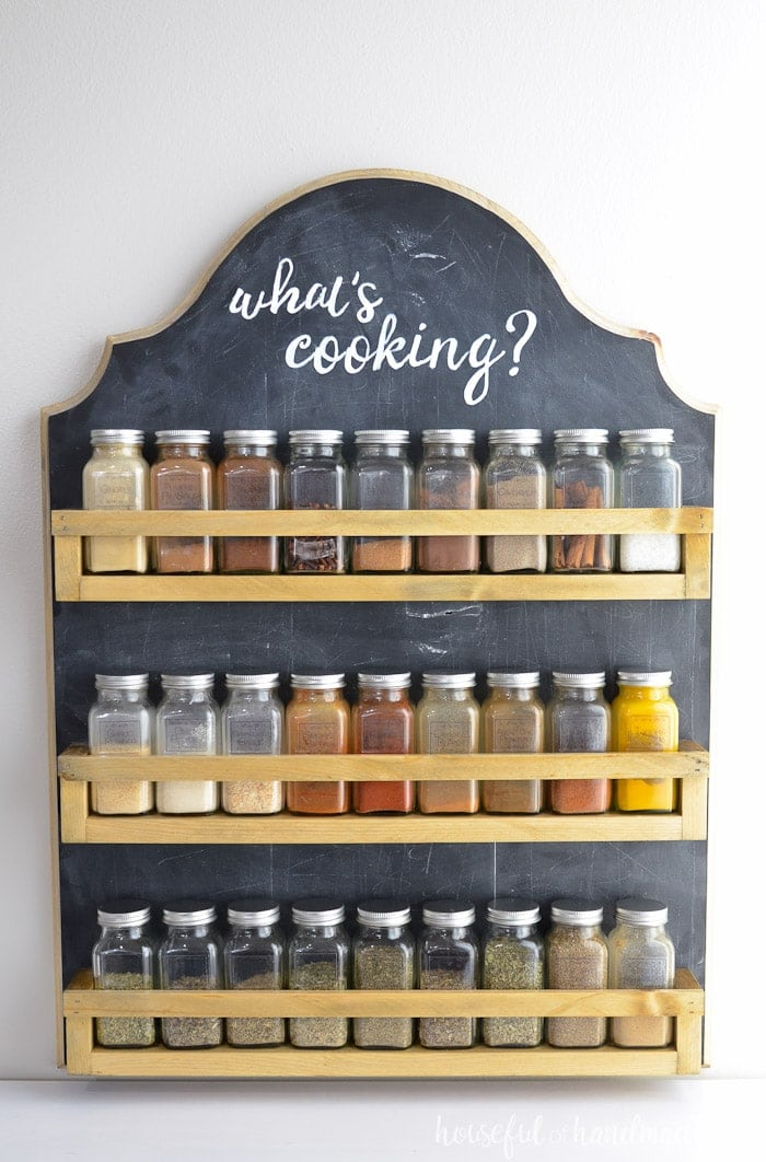 Farmhouse spice rack with chalkboard paint hanging on wall