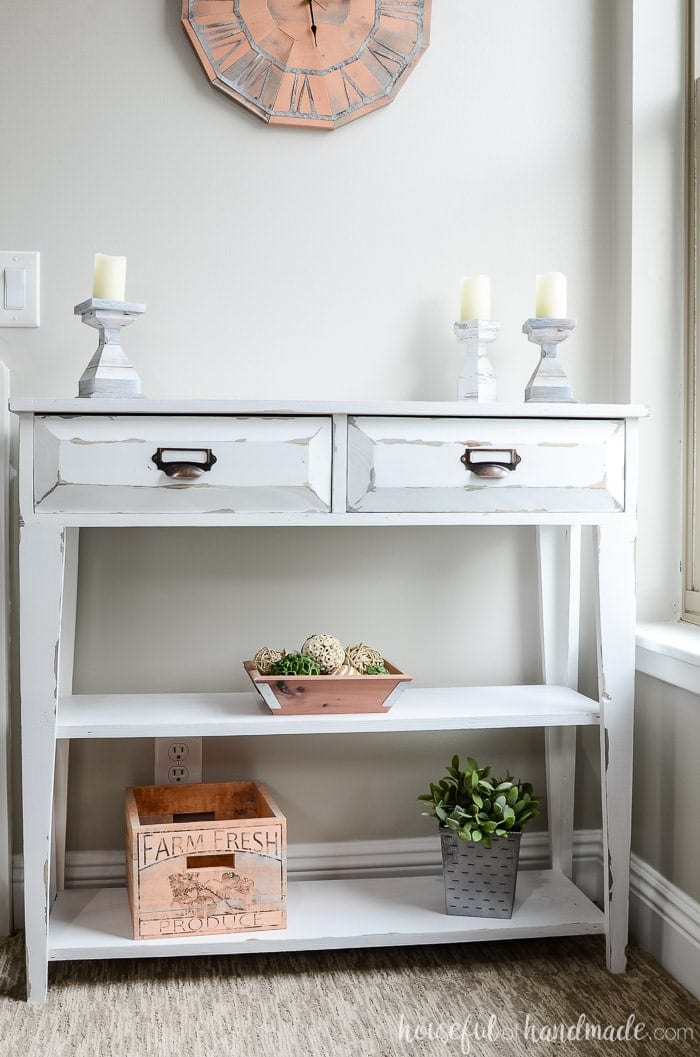 Farmhouse style small console table with 2 drawers and open shelving.