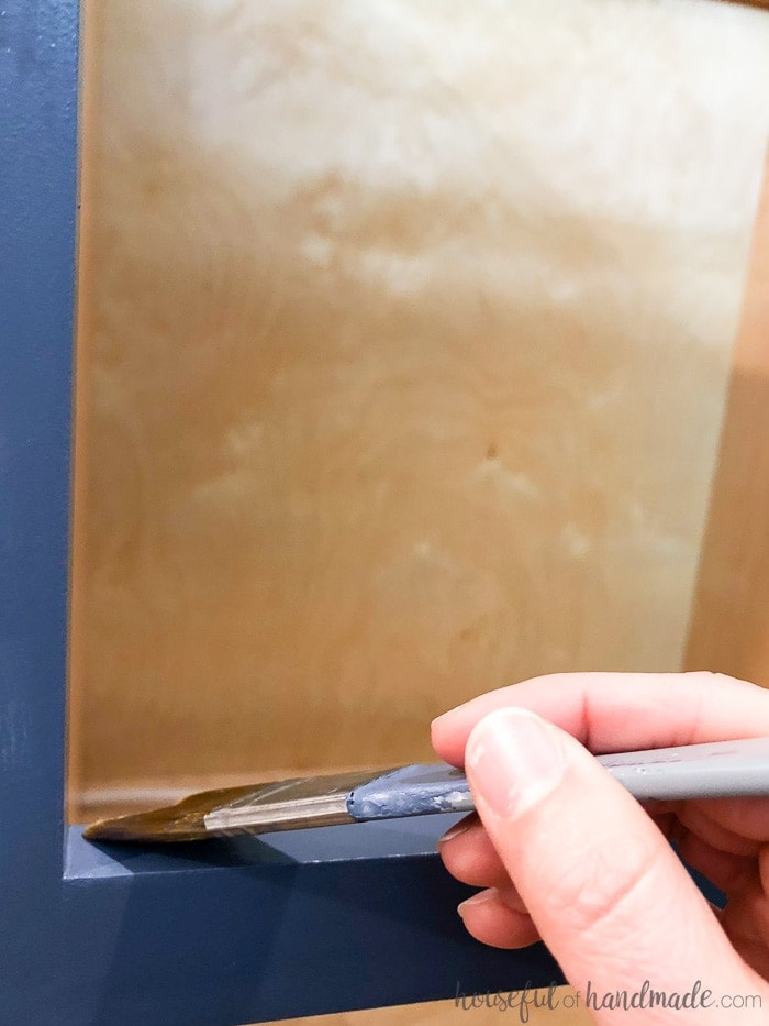 Apply a protective finish to your painted kitchen cabinets to give them an extra layer of protection. See all the tips for how to paint unfinished cabinets. Housefulofhandmade.com