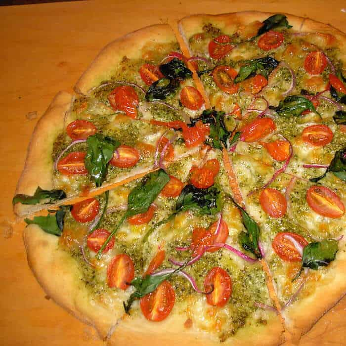 Pizza with Homemade Dough, Grape Tomatoes and Spinach.