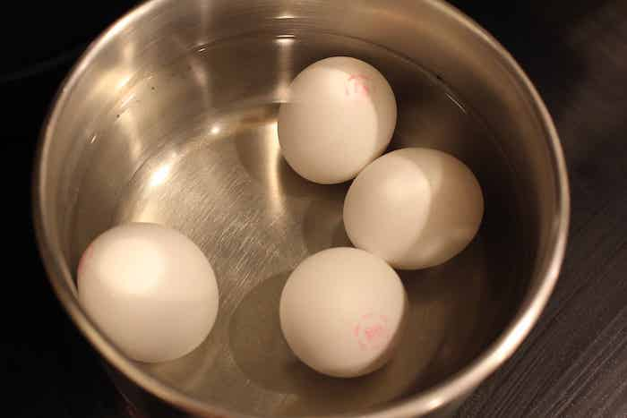 Step 1: Gently put the eggs in a pot and cover them with water.