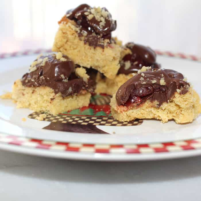 Chocolate Cherry Squares Cookies are so pretty on the plate and people love them.