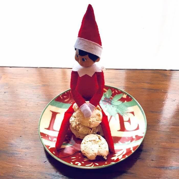 """""""Who me?"""" says El Cocinero, the mischievous elf. """"I didn't take a bite out of your Coconut Kiss!"""" Luckily, the Coconut Kiss Cookie recipe makes a LOT of cookies and they are only about 59 calories each. So have a couple!"""