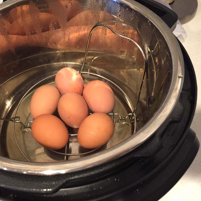 See the metal insert? That keeps the eggs from rolling around and breaking during the cooking process.