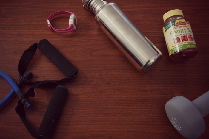 Exercise equipment, water bottle, and Nature Made vitamins