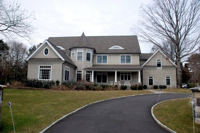 front of shingle style home in westport ct by demotte architects