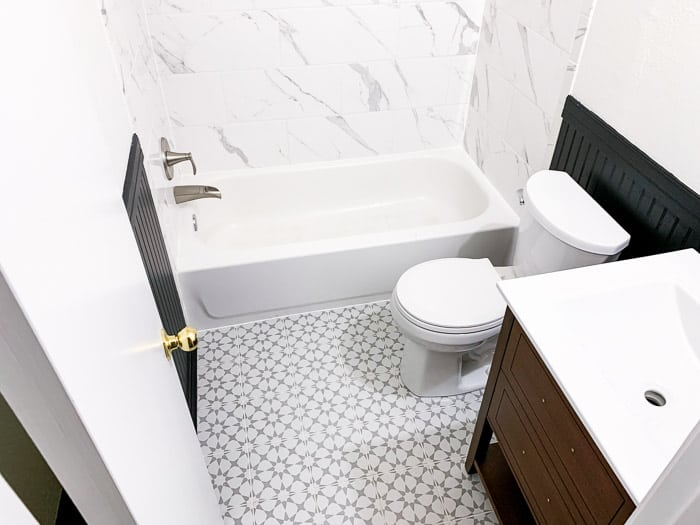 black and white bathroom with black beadboard walls