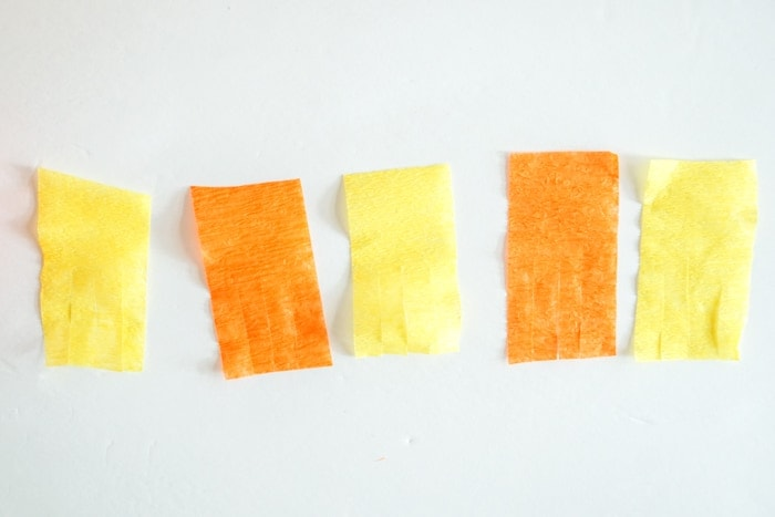 three piece of fringed crepe paper