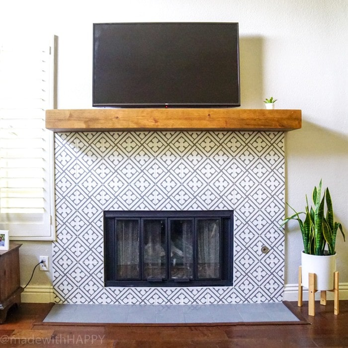 Modern Fireplace Makeover. Just like cement tile fireplace, but Portuguese ceramic tile fireplace. Modern Grey and white patterned tile. Rustic Mantel. Chunky reclaimed wood mantel.