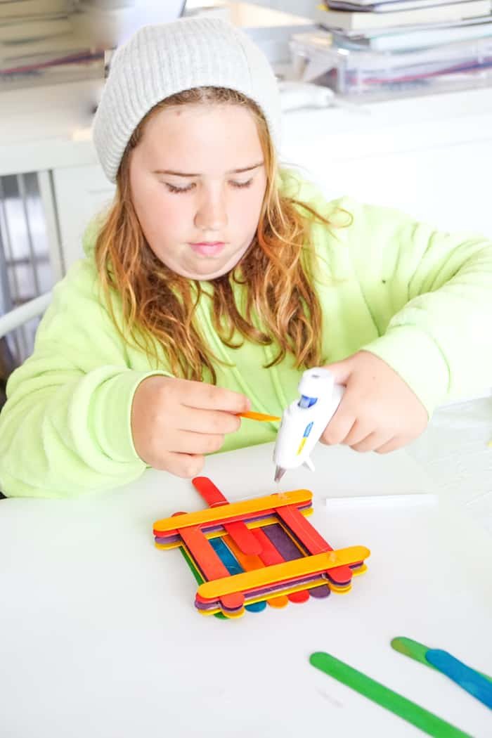 child making birdfeeder