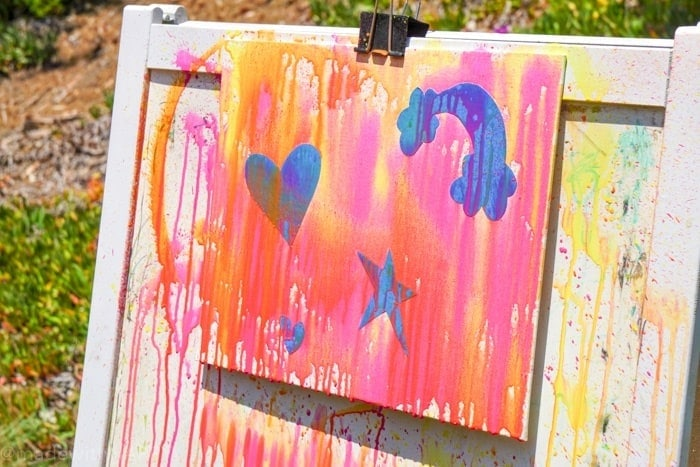 Mixed Media Kids Activities. Water gun painting. Looking for Summer activities for the kids? The kids LOVE water gun painting throughout the Summer.