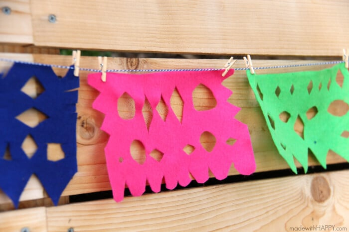 DIY Papel Picado   Felt Papel Picado   DIY Mexican Cutout Banner   Cinco De Mayo Decorations   Fiesta Decorations   Homemade Party Decorations Mexican Fiesta   www.madewithhappy.com