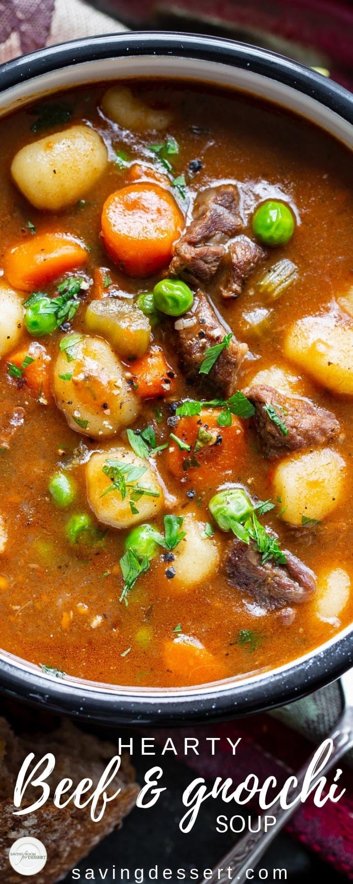 Hearty Beef and Gnocchi Soup is a warming and delicious chunky soup worthy of an entire meal. Serve with crusty bread to sop up all the delicious broth! #savingroomfordessert #heartystew #heartysoup #soup #beefsoup #vegetablebeefsoup #gnocchisoup