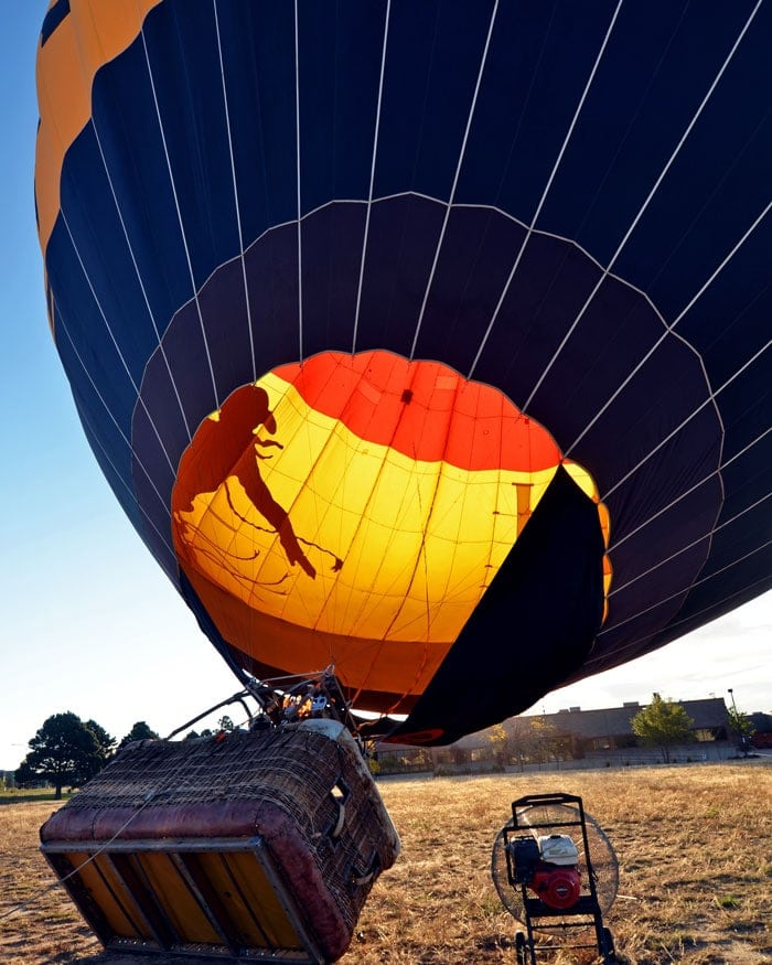 Hot Air Balloon almost fully inflated with a fan blowing the hot air into the balloon