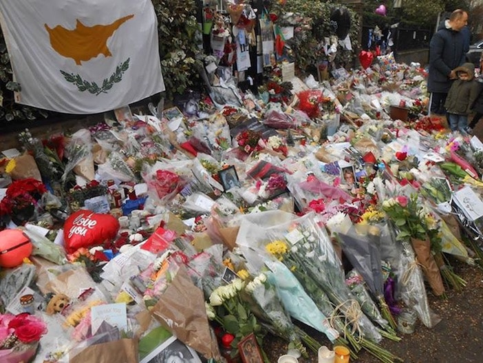 The flag of Cyprus is on prominent display at the make-shift memorial outside Michael's home.