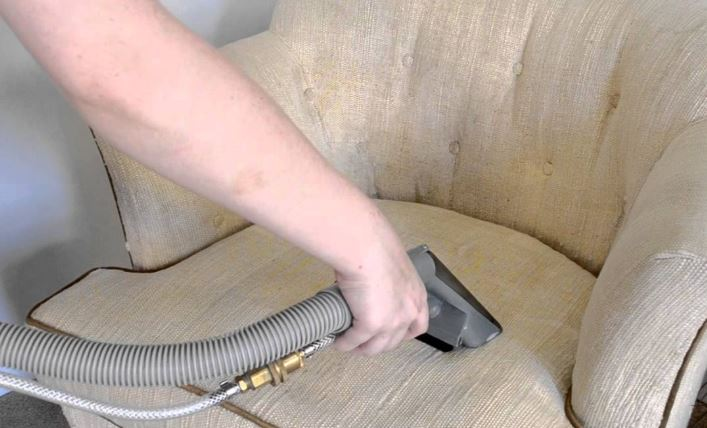 applying the steam upholstery cleaning process