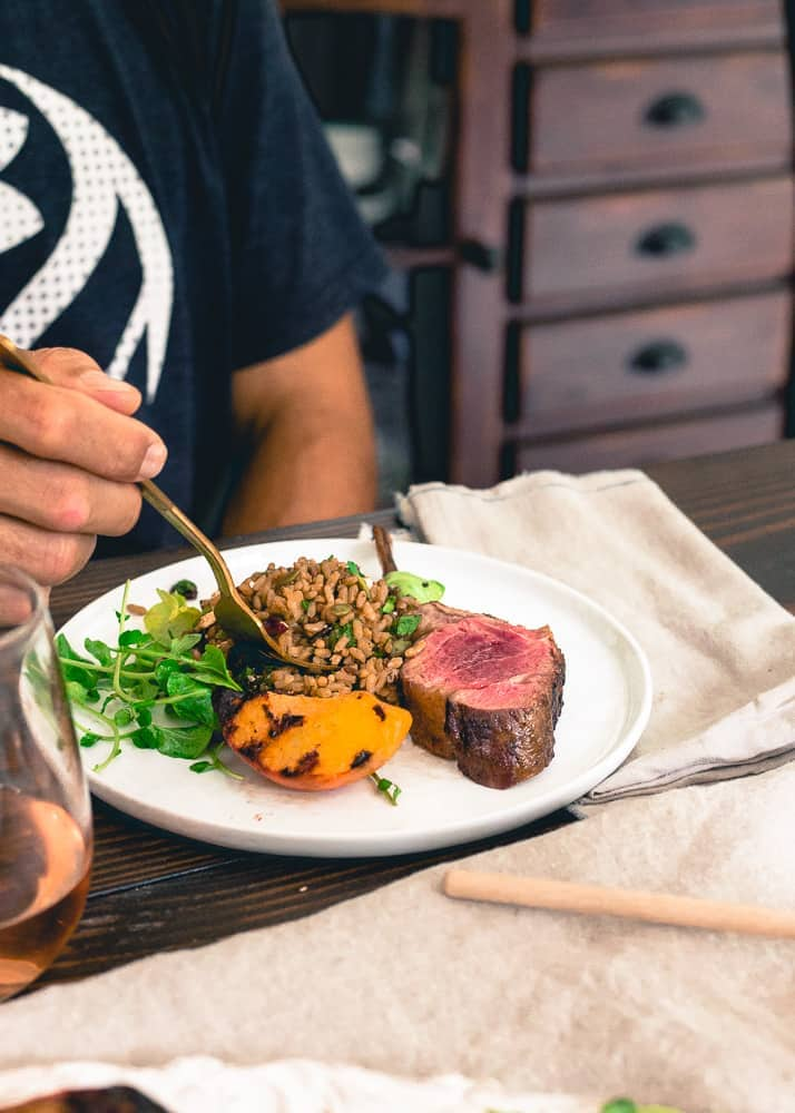Wild rice, grilled peaches and a watercress salad go perfectly with these grilled lamb chops with peach honey.