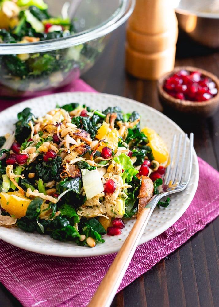 Crispy rotisserie chicken, pomegranates, oranges and toasted pine nuts are tossed with chopped kale and an orange dijon dressing.