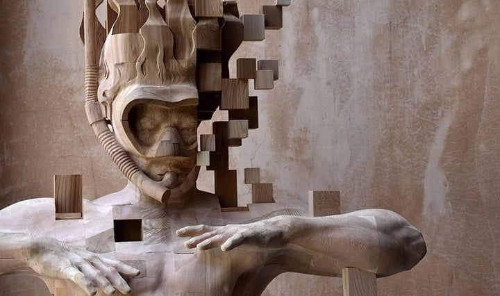A Pixelated Wooden Snorkeler Sculpted by Hsu Tung Han