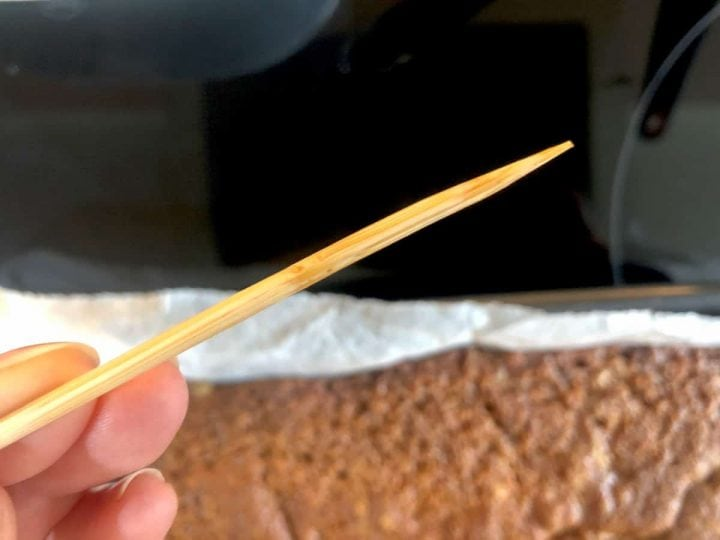testing the cake with a skewer