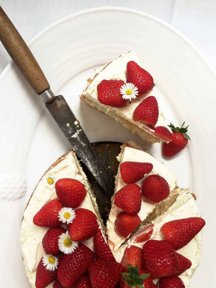 Simple strawberry layer cake with whipped cream