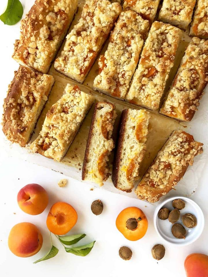 Yeast dough cake with fruit and coconut crumble