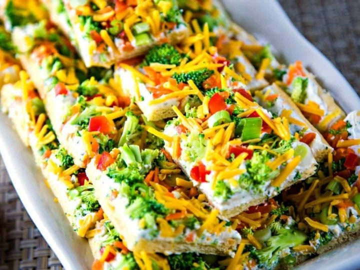 cool veggie pizza squares on a white serving tray