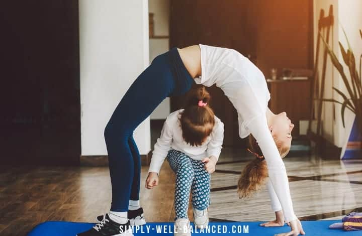Mom and daughter doing yoga together family fitness