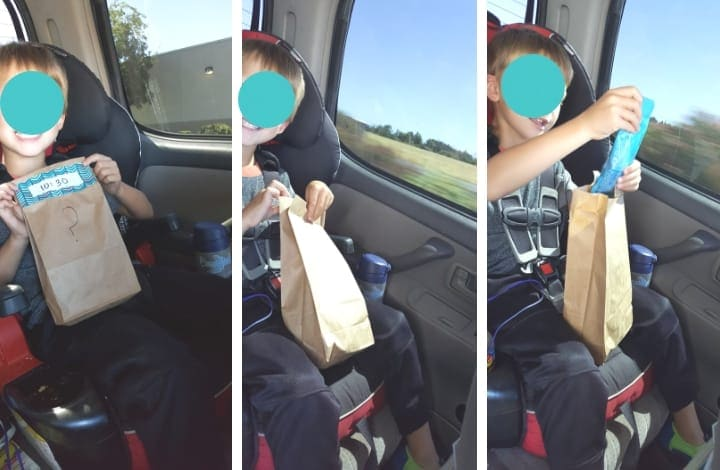 Toddler opening road trip busy bag