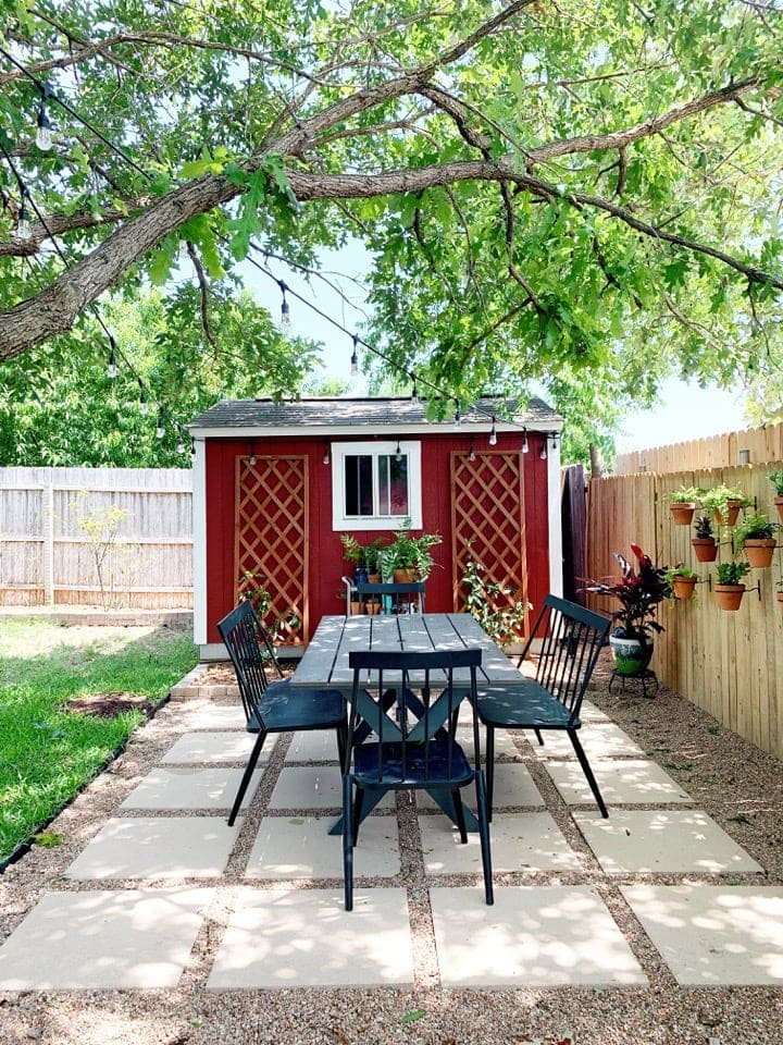 pea gravel and paver patio with red storage shed