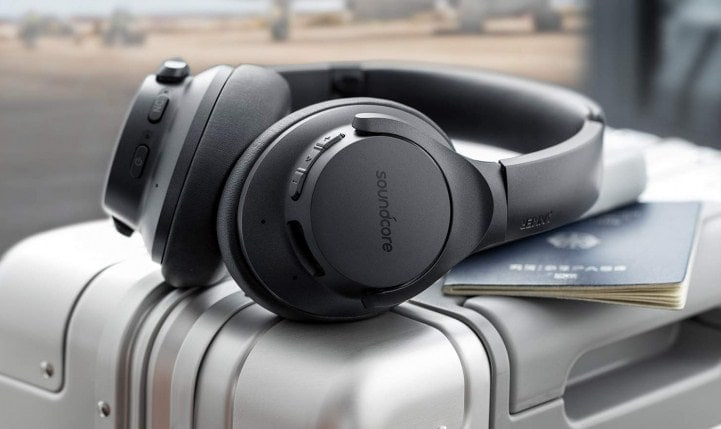 close up headphone on travel luggage and passport
