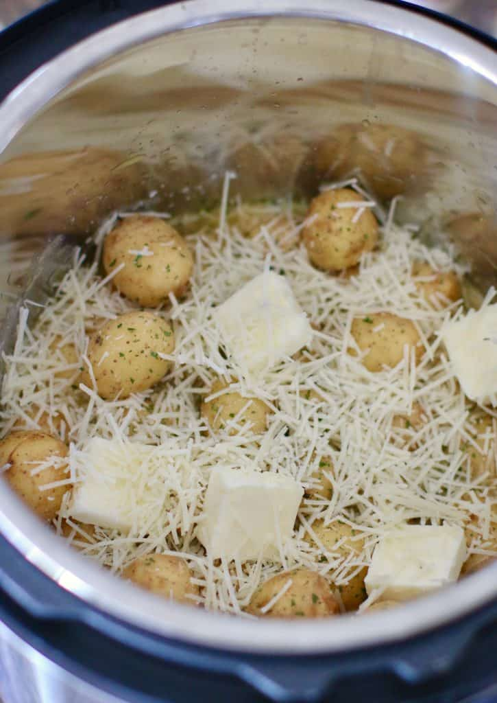baby potatoes. chicken broth, butter, garlic, Parmesan cheese