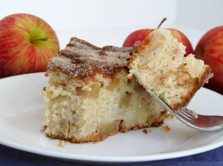 Cinnamon Apple Cake. Chock full of apples, this cake gets a wonderful richness from cream cheese and a spicy sweetness from a dusting of cinnamon sugar.